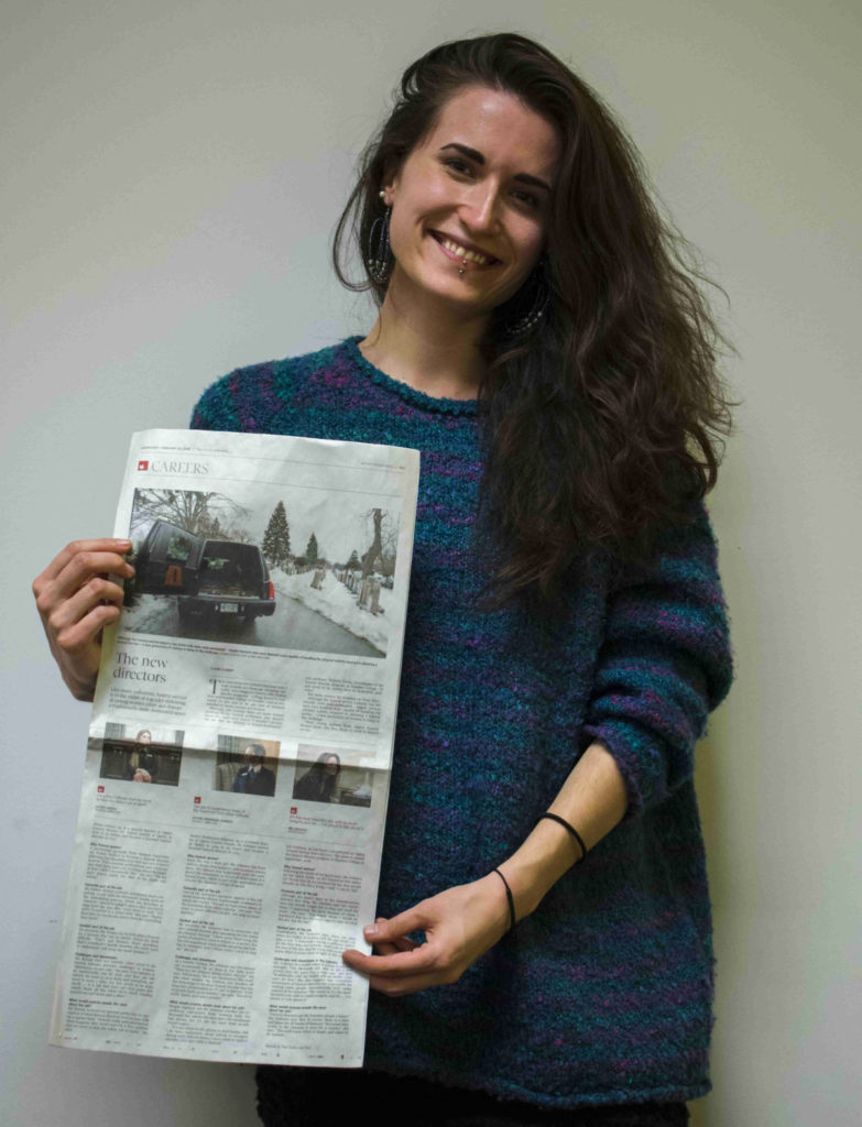 Claire Floody, 24, with her copy of the Globe and Mail she picked up on Valentine's Day. Claire travelled to Australia, Europe and Asia over a 19 month period before deciding to pursue journalism. (Bobby Hristova)