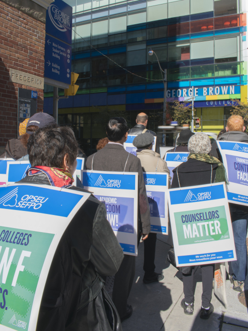 TORONTO, ONTARIO; October 17, 2017 - Part-time and full-time faculty at George Brown college march in protest around campus at noon. Today, 23 other Ontario colleges are on strike after negotations between OPSEU and College Employer Council fell through.