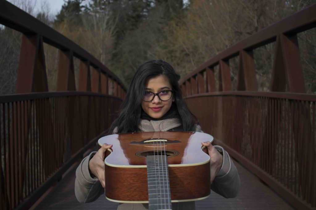 TORONTO, ON - 12/11/17: University of Toronto Media Studies student and musician Ashwini Paradkar started playing guitar after leaving her drums behind in her home, Hyderabad, India. After three years without drums, Paradkar decided she needed a way to express herself through music while at school and bought a Vester acoustic guitar for $100. Her favourite music genre is classic rock.