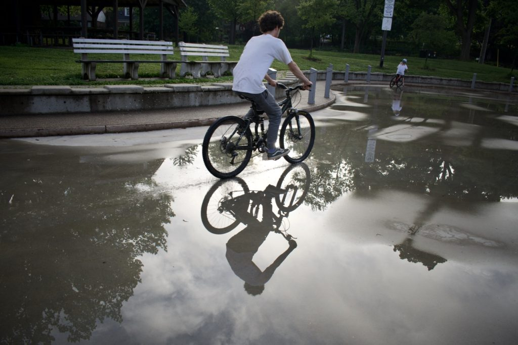Biking refection in puddle