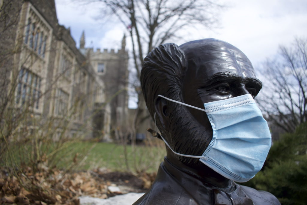 McMaster Statue with face mask during COVID-19